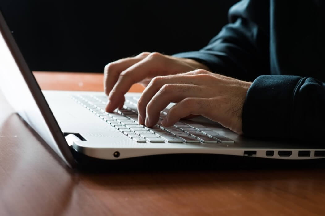 Author writing Alpha Male Story on Laptop